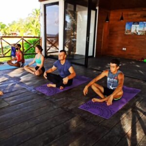 Group Yoga Class By the Sea in Puerto Morelos